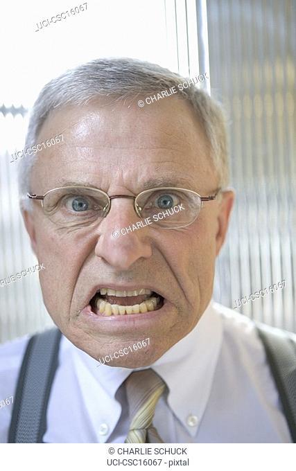 Angry businessman grimacing