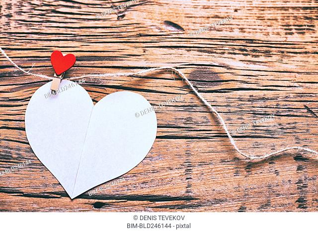 Paper heart hanging on string with clothespin