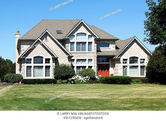 Luxury home in suburbs with red door