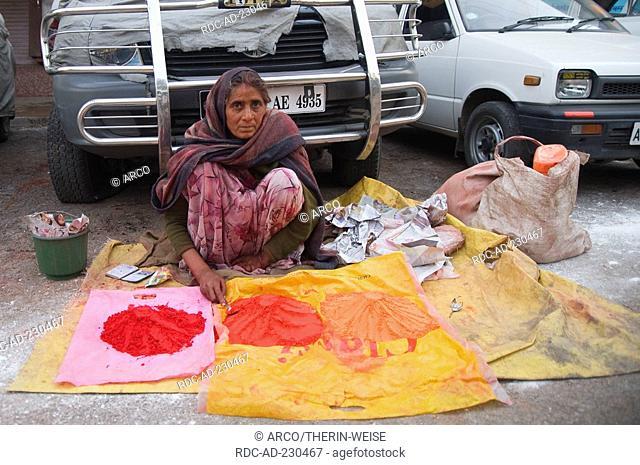 Indian woman selling religious accessories at ghats, Varanasi, Benares, Uttar Pradesh, India