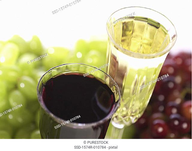 Close-up of glasses of red and white wine