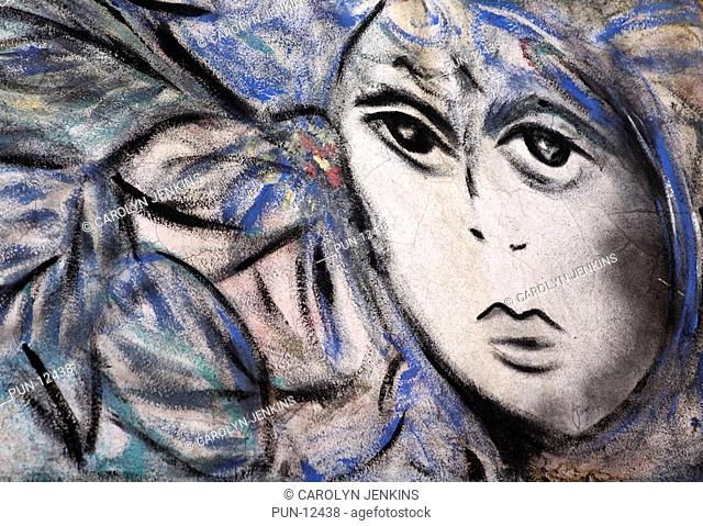 Cuban artwork of face painted on wall at Havana, Cuba, West Indies, Caribbean, Central America