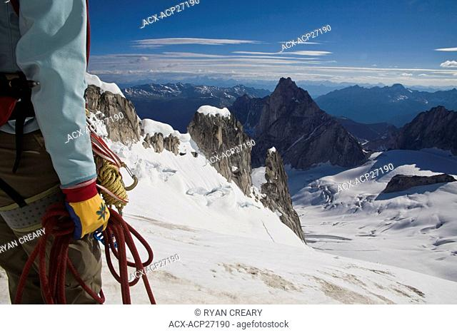 A female climber ascends the Northeast Ridge - North Howser, Bugaboos, BC