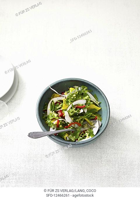 Colourful coconut salad with Asian dressing