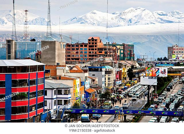 A panoramic view of snow covered peaks of the Andes mountains, with a highway traffic jam in the foreground, is seen in the city of El Alto, Bolivia