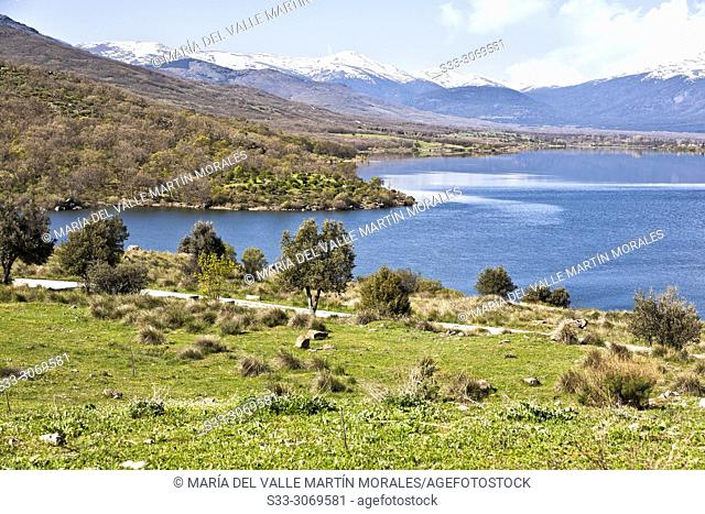 The pinilla reservoir in a sunny day and Sierra de Guadarrama on the background. Madrid. Spain