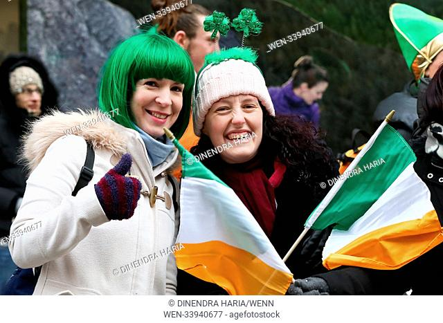 Performers take part in the annual St. Patrick's Day Parade in central London, as tens of thousands of people watch the parade