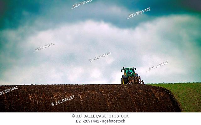 Tractor plowing, Maurs, Cantal, Auvergne, France