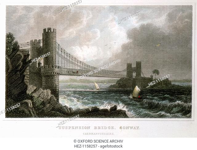Suspension bridge over the Conwy estuary, Wales, c1840. One of the earliest iron suspension bridges, built by Thomas Telford (1757-1834)