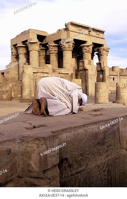 Muslim man praying towards Mecca