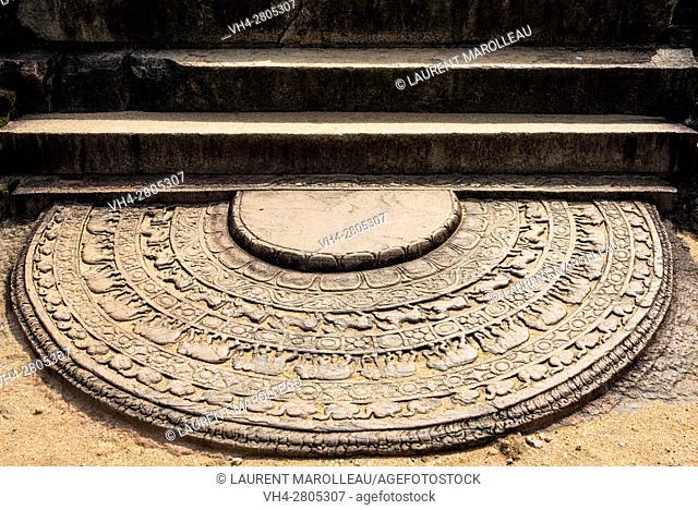 Sandakada pahana, also known as Moon-stone at Baddasima Prasada or Chapter House of the Monks of the Alahana Pirivena Monastery Complex built by the King...