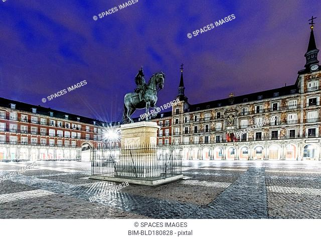 Ornate building and statue illuminated at night, Madrid, Madrid, Spain