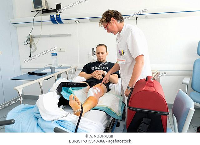 Reportage in the orthopedic surgery service in Saint George Clinic, Nice, France. Treating a torn cruciate ligament with ligament surgery using the Sambba...