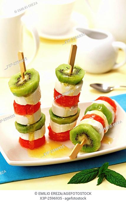 Kiwifruit and watermelon skewers with cheese