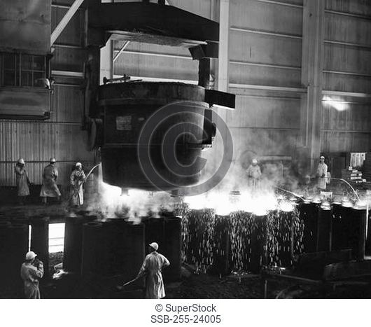 Molten steel being poured into molds in a steel factory