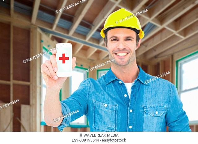Composite image of happy carpenter showing smart phone