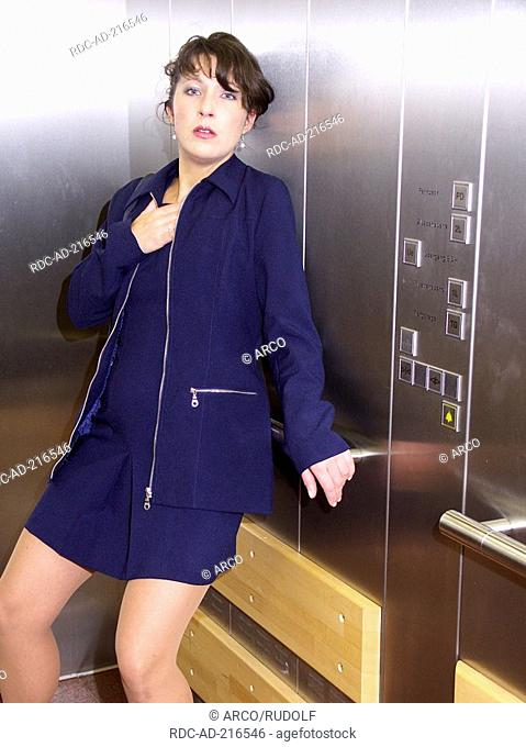 Woman in lift having panic, elevator, Claustrophobia