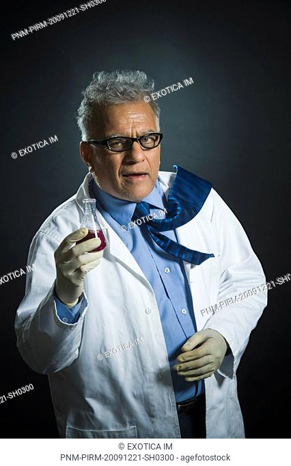 Scientist holding a chemical flask