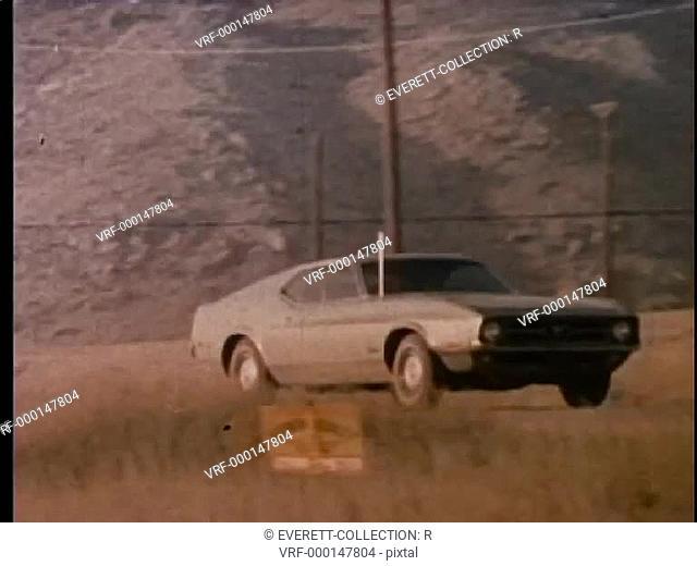 Car turning off dirt road