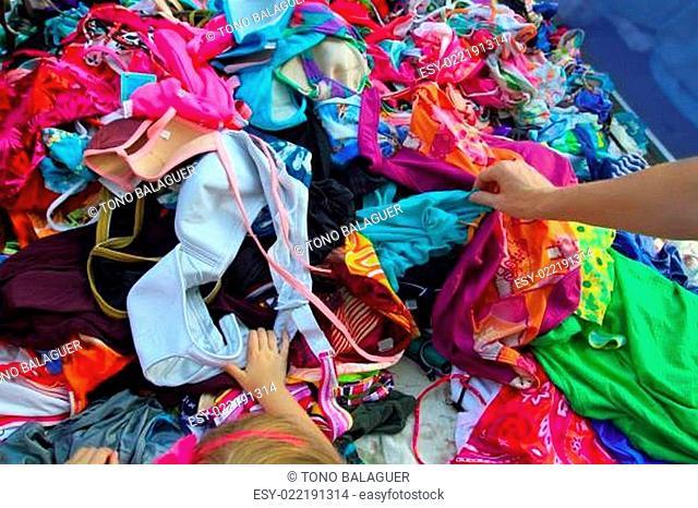 Fashion clothes bargain sale woman hands picking