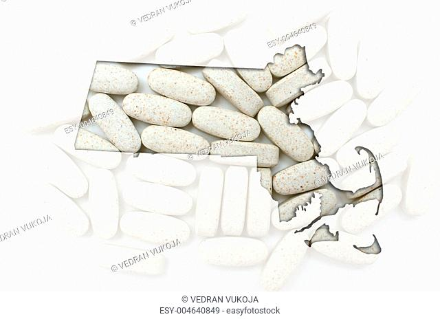 Outline map of Massachusetts with transparent pills in the backg