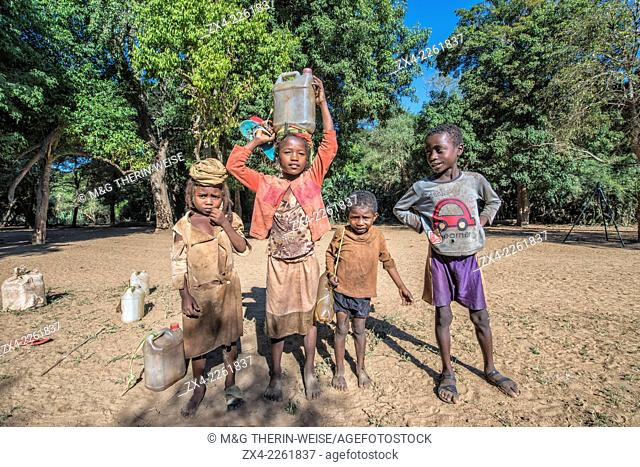Children carrying water from the river , Berenty, Fort Dauphin, Toliara Province, Madagascar