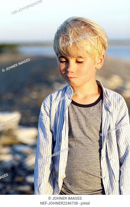 Portrait of blond boy on sea coast