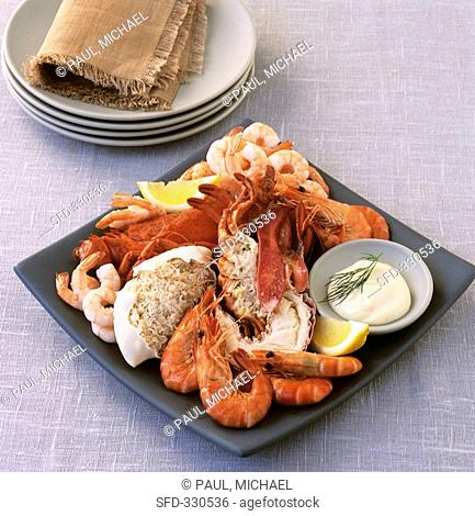 Seafood platter with mayonnaise and lemon