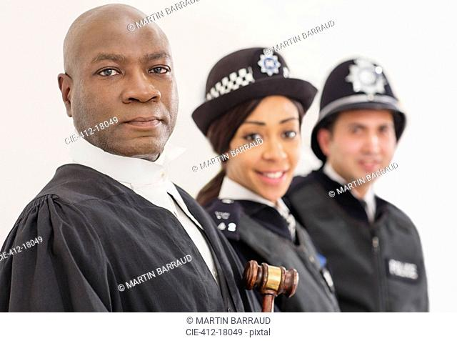Portrait of confident judge and police