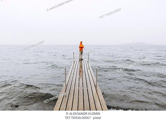 Young man on pier on Iceland