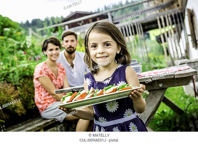 Young family preparing picnic lunch, Tyrol, Austria