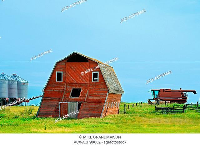 Leaning barn and combine Loreburn Saskatchewan Canada