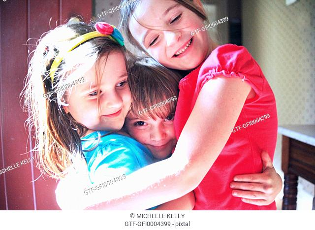 Group of kids hugging happily