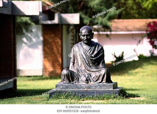 Statue of Gandhi in Gandhi museum complex , Ahmedabad , Gujarat , India