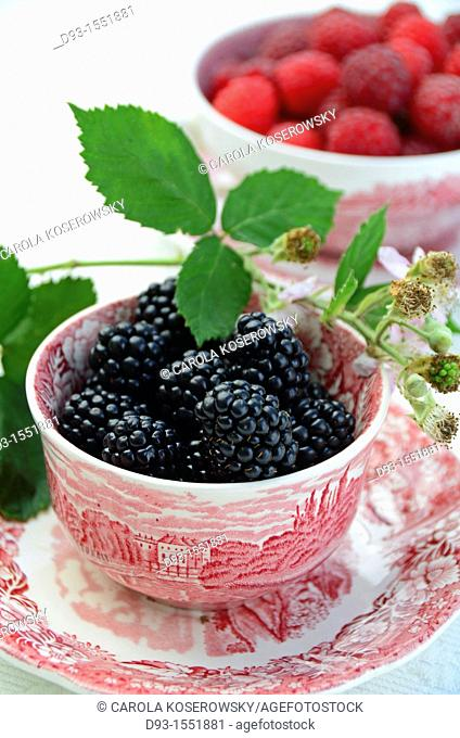 blackberries in a antique bowl with leaves