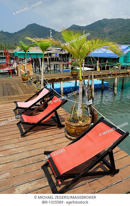 Red deck chairs on the pier in the Bang Bao bay, Koh Chang Island, National Park Mu Ko Chang, Trat, Gulf of Thailand, Thailand, Asia