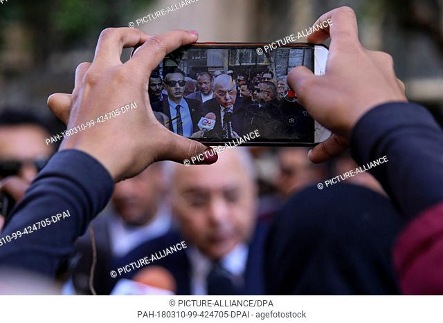 dpatop - A woman takes a picture of Egyptian Presidential candidate and leader of El-Ghad Party Moussa Mostafa Moussa, as he speaks to media during an election...