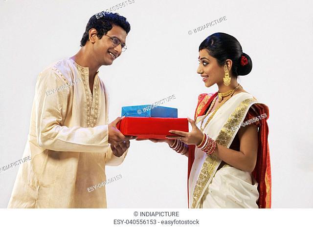 Bengali couple holding gifts