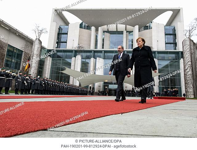 01 February 2019, Berlin: Federal Chancellor Angela Merkel (CDU) welcomes Nikol Paschinyan, Prime Minister of Armenia, with military honours before the Federal...