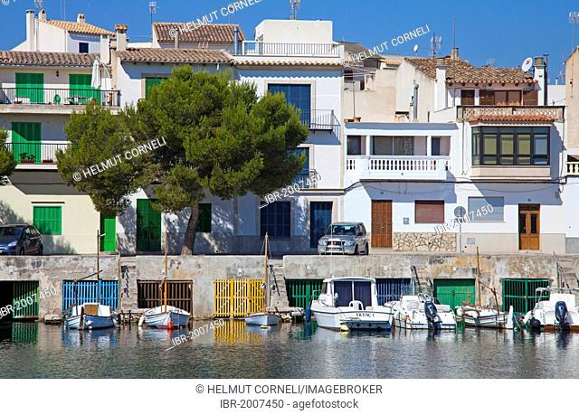 Fishermen's houses with boathouses underneath, harbour, Porto Colom, Felanitx, Majorca, Balearic islands, Spain, Mediterranean Sea, Europe