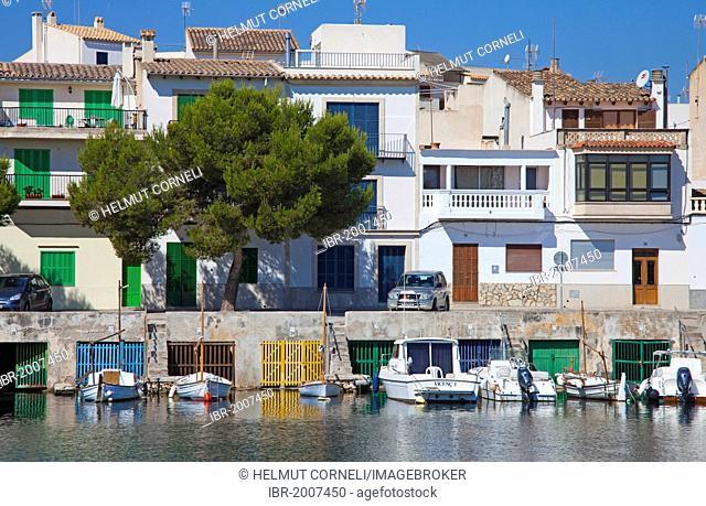 Fishermen's houses with boathouses underneath, harbour, Porto Colom, Felanitx, Majorca, Balearic islands, Spain, Mediterranean Sea, Europe