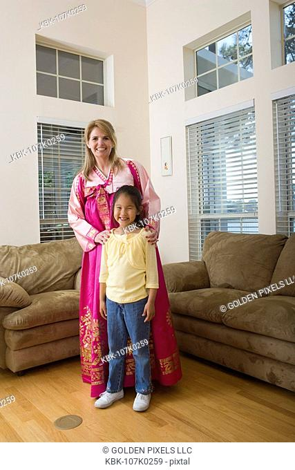 Mother and daughter in living room, mother wearing a Hanbok