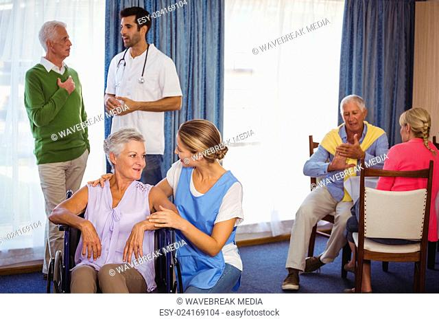 Nurses having discussions with seniors patients