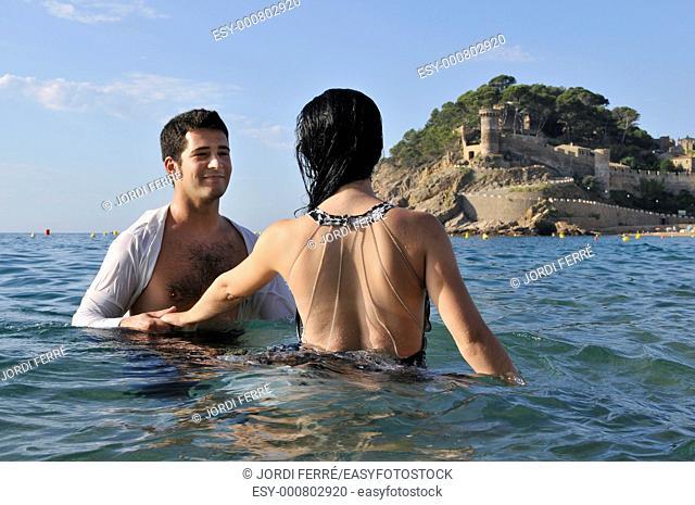 Young couple on the beach, Tossa de Mar, Costa Brava, Girona, Spain, Europe