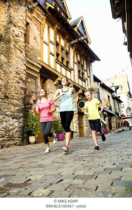 Caucasian women jogging in village