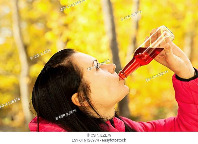 Young woman with a drink