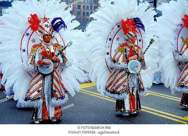parade, band, Philadelphia, PA, Pennsylvania, Members of a String Band dressed in ornate patriotic costumes play their banjos and strut in the Mummers Day...