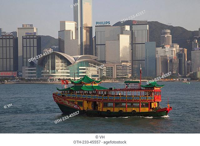 Wanchai skyline from Kowloon with a sightseeing boat in foreground, Hong Kong