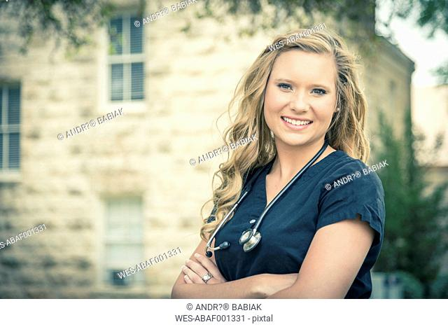 Portrait of smiling young female nurse