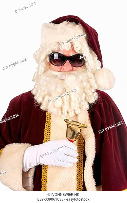 Portrait of Santa Claus with sunglasses and copper bell